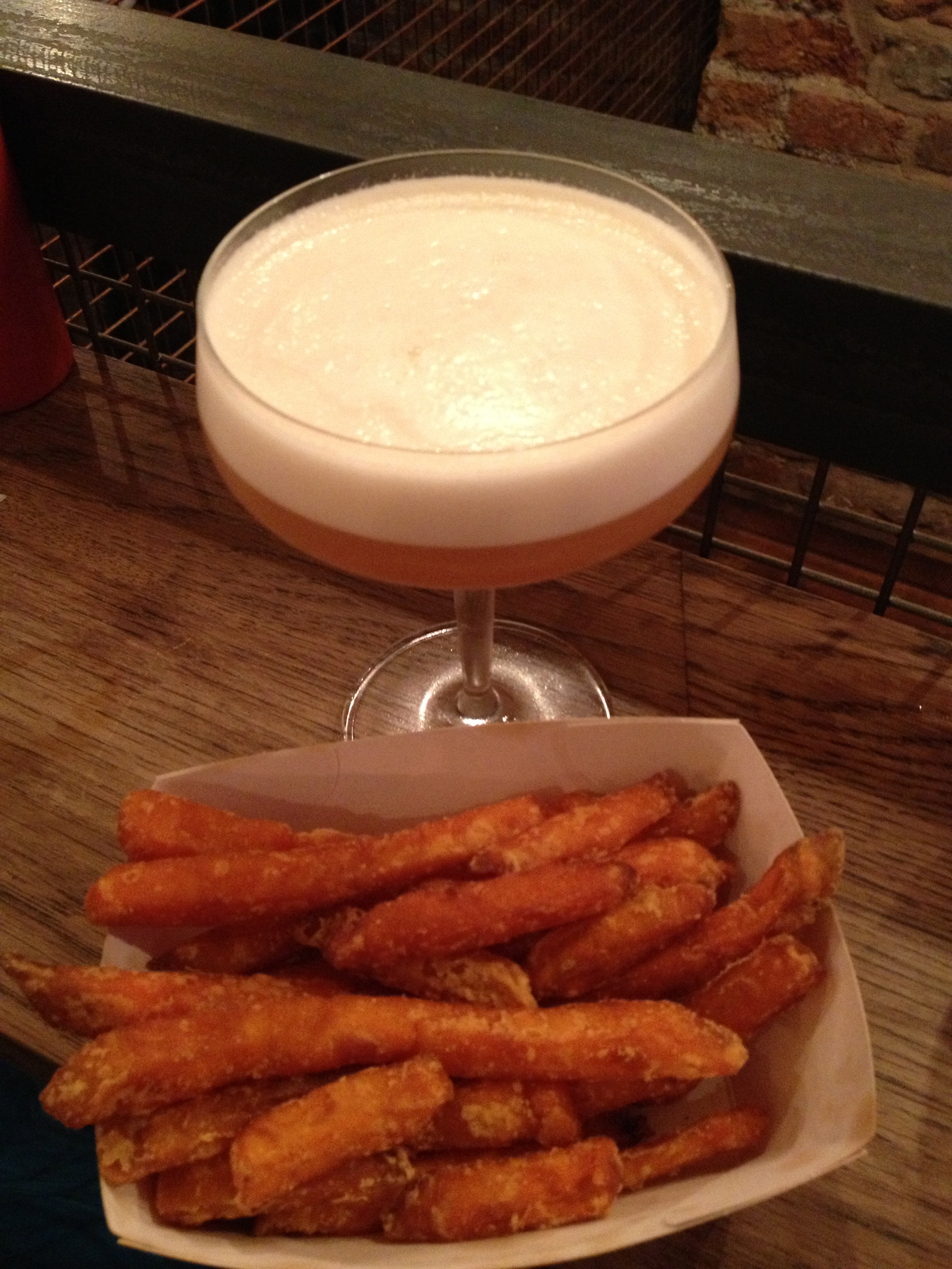 The Quince Sour with a side of sweet potato fries