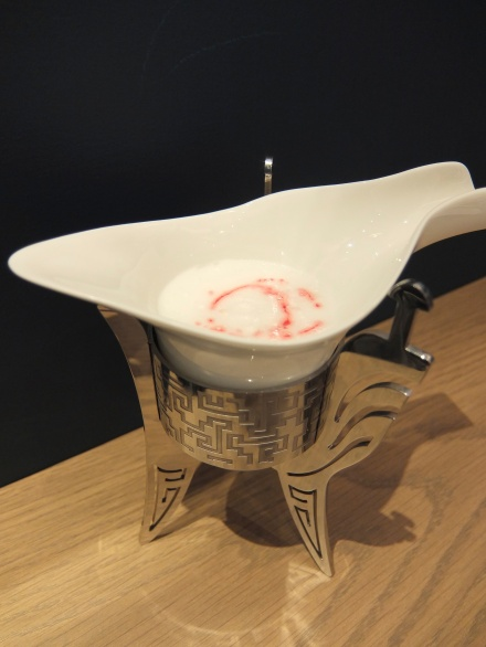 Bai Jiu Sour - stick your mouth at the end of the spout and try drinking without making a fool of yourself!